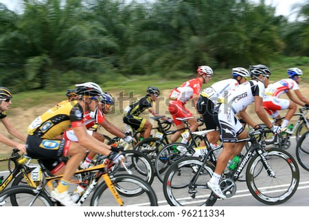 MELAKA,MALAYSIA - FEBRUARY 26 : The largest group of cyclists from various teams cycle during Stage 3 of the Tour de Langkawi from Melaka to Parit Sulong on February 26, 2012 in Melaka, Malaysia. - stock photo