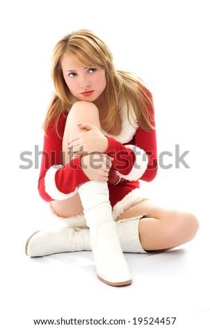 melancholic beautiful girl dressed as Santa - stock photo