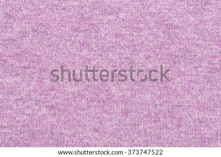 melange purple woolen knitted fabric as background - stock photo