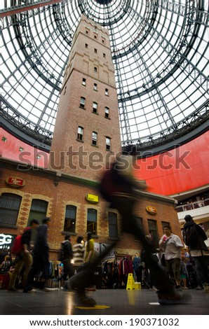 MELBOURNE - APR 11 2014:Shoppers at Melbourne Central, famous shopping centre and public transport hub contained inside it's dome the Coop's Shot Tower which was built on the site in 1888. - stock photo