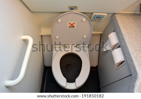 MELBOURNE  - APRIL 15 2014:Aircraft lavatory toilets aboard a jetliner airplane.On board airline carriers, The standard ratio of lavatories to passengers is 1 lavatory for every 50 passengers. - stock photo