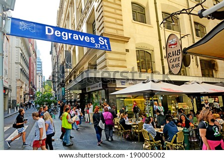 MELBOURNE, AUS - APR 11 2014:Traffic on Degraves Street, one of Melbourne's finest Laneway environments. Full of bars,restaurants, cafe and boutique shopping. - stock photo