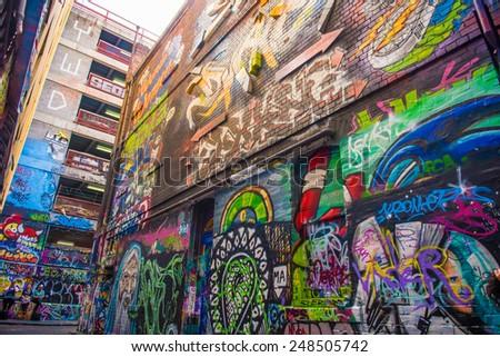 MELBOURNE, AUS - December 30 2014:Graffiti artwork in Hosier Lane.Hosier lane is a much celebrated landmark in Melbourne mainly due to its sophisticated graffiti urban art. - stock photo