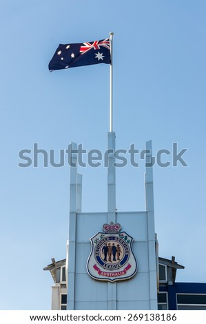 MELBOURNE, AUSTRALIA - April 5, 2015: the Australian flag flying above the RSL Club in Glen Waverley in the month leading up to the 100th anniversary of ANZAC Day, commemorating landings at Gallipoli. - stock photo