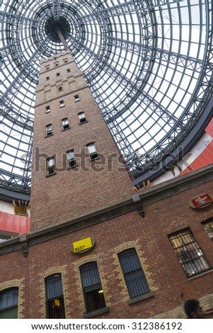 Melbourne, Australia - August 1, 2015: Coop's Shot Tower in Melbourne Central, Melbourne underneath an 84 m-high conical glass roof during daytime.  - stock photo