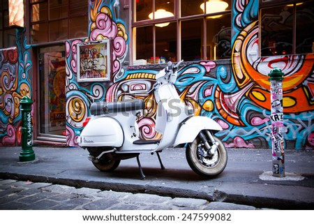 Melbourne, Australia - December 20 - Melbourne's famous Hosier Lane with motorcycle and graffiti on December 20th 2013. - stock photo