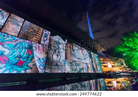 MELBOURNE, AUSTRALIA - February 22, 2014: projections of images of tattoos and tattooed people onto the National Gallery of Victoria (NGV) during the White Night arts festival. - stock photo