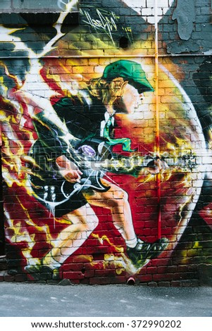 MELBOURNE/AUSTRALIA - FEBRUARY 6: Taken in Melbourne's famous graffiti laneways, this mural of AC/DC's Angus YOung was found in AC/DC Lane, Mlebourne. - stock photo