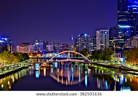 Melbourne Australia February 23 2015 The city skyline in HDR at night reflected in the Yarra River. - stock photo