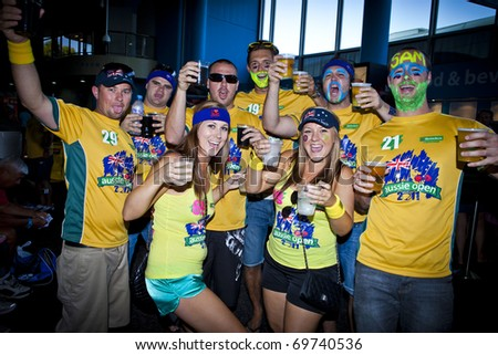 MELBOURNE, AUSTRALIA - JANUARY 22: A group of Australian supporters with beers inside the Rod Laver Arena which holds the center court at the Australian Open, January 22, 2011 in Melbourne, Australia - stock photo