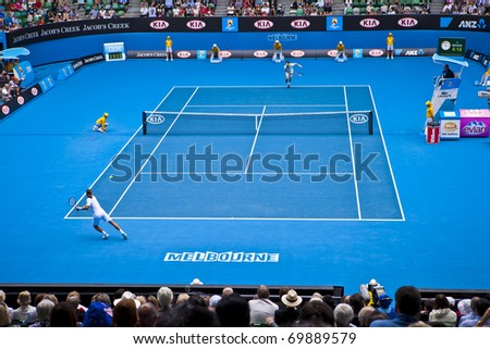 MELBOURNE, AUSTRALIA - JANUARY 26: Andy Murray(GBR)[5] and Alexandr Dolgopolov(UKR) on centre court at the Australian Open on January 26, 2011 in Melbourne, Australia - stock photo