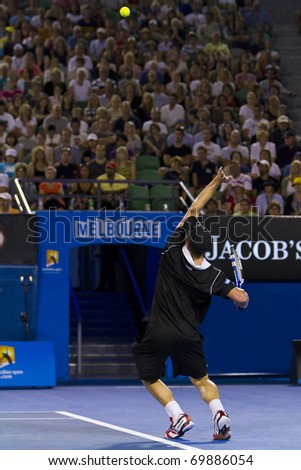 MELBOURNE, AUSTRALIA - JANUARY 23: Andy Roddick(USA)[8] who was defeated by Stanislas Wawrinka(SUI)[19] at the Australian Open on January 23, 2011 in Melbourne, Australia - stock photo