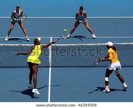 MELBOURNE, AUSTRALIA - JANUARY 24: Doubles match Serena & Venus (Front L) Williams vs Andrea Hlavackova & Lucie Hradecka at the 2010 Australian Open on January 24, 2010 in Melbourne, Australia - stock photo
