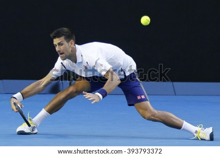 MELBOURNE, AUSTRALIA - JANUARY 24, 2016: Eleven times Grand Slam champion Novak Djokovic of Serbia in action during his round 4 match at Australian Open 2016 at Rod Laver Arena in Melbourne Park - stock photo