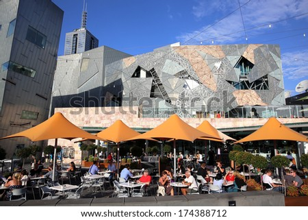 MELBOURNE, AUSTRALIA - JANUARY 11, 2013:  Federation Square in the Heart of Melbourne on January 11, 2013. Its a popular place for tourists and local people. - stock photo