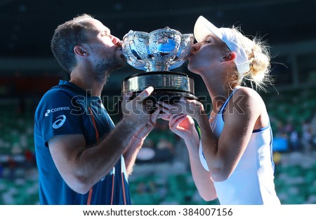 MELBOURNE, AUSTRALIA - JANUARY 31, 2016: Grand Slam champions Bruno Soares of Brazil (L) and Elena Vesnina of Russia during trophy presentation after mixed doubles final match at Australian Open 2016 - stock photo