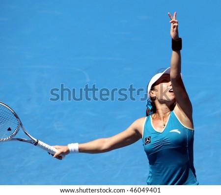 MELBOURNE, AUSTRALIA - JANUARY 26: Jie Zheng in action at her quarter final win over Maria Kirilenko during the 2010 Australian Open on January 26, 2010 in Melbourne, Australia - stock photo