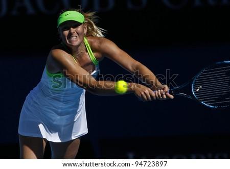 MELBOURNE, AUSTRALIA - JANUARY 26: Maria Sharapova of Russia hits a return to Petra Kvitova of Russia during Australian Open tennis tournament, January 26, 2012 in Melbourne, Australia. - stock photo