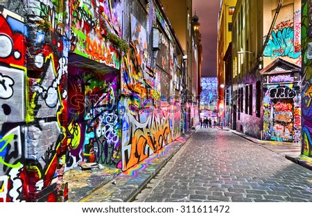 Melbourne, Australia - January 18, 2015: Night view of colorful graffiti artwork at Hosier Lane in Melbourne on January 18, 2015. - stock photo