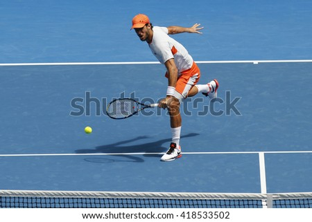MELBOURNE, AUSTRALIA - JANUARY 25, 2016: Professional tennis player Feliciano Lopez of Spain in action during his round 3 match at Australian Open 2016 at Rod Laver Arena in Melbourne Park - stock photo