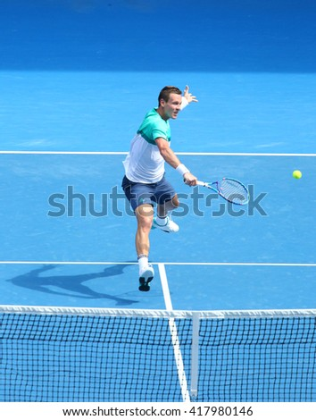 MELBOURNE, AUSTRALIA - JANUARY 26, 2016: Professional tennis player Tomas Berdych of Czech Republic in action during his quarterfinal match at Australian Open 2016 in Melbourne Park - stock photo