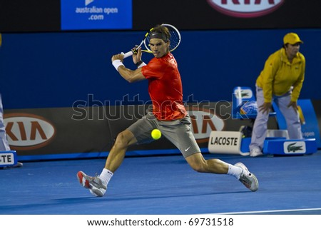 MELBOURNE, AUSTRALIA - JANUARY 22: Rafael Nadal(ESP)[1] who defeats Bernard Tomic (AUS) at the Australian Open on January 22, 2011 in Melbourne, Australia - stock photo
