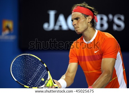 MELBOURNE, AUSTRALIA - JANUARY 22: Rafael Nadal of Spain in his win over Phillipp Kohlschreiber  in the 2010 Australian Open at Melbourne Park on January 22, 2010 in Melbourne, Australia - stock photo