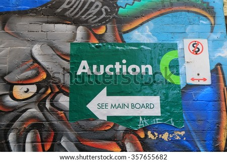 MELBOURNE AUSTRALIA - JANUARY 2, 2016: Real estate austion sign in Melbourne downtown.  - stock photo