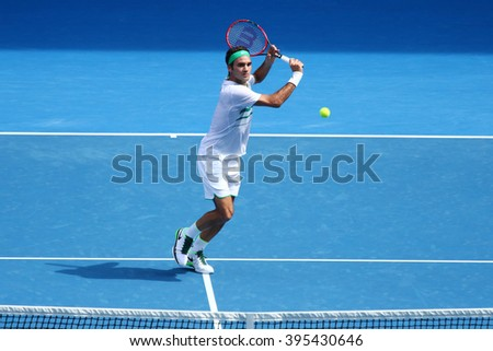 MELBOURNE, AUSTRALIA - JANUARY 26, 2016: Seventeen times Grand Slam champion Roger Federer of Switzerland in action during quarterfinal match at Australian Open 2016 in Melbourne Park - stock photo