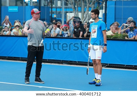 MELBOURNE, AUSTRALIA - JANUARY 27, 2016: Six times Grand Slam champion Boris Becker coaching Novak Djokovic for Australian Open 2016 at Australian tennis center in Melbourne Park - stock photo