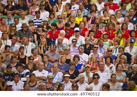 MELBOURNE, AUSTRALIA - JANUARY 22: Some of the sell out crowd inside the Rod Laver Arena, center court at the Australian Open, January 22, 2011 in Melbourne, Australia - stock photo