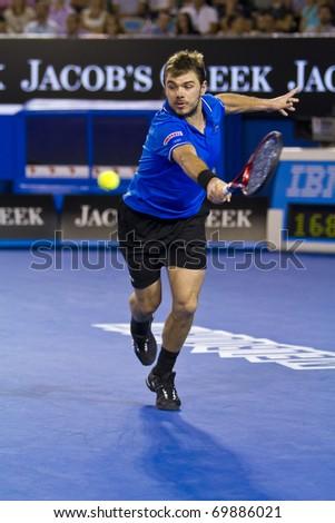 MELBOURNE, AUSTRALIA - JANUARY 23: Stanislas Wawrinka(SUI)[19] who defeated Andy Roddick(USA)[8] at the Australian Open on January 23, 2011 in Melbourne, Australia - stock photo