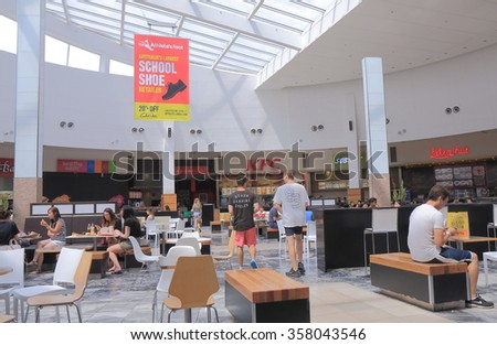 MELBOURNE AUSTRALIA - JANUARY 1, 2016: Unidentified people dine at food court High Point shopping mall.   - stock photo