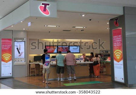 MELBOURNE AUSTRALIA - JANUARY 1, 2016: Unidentified people shop at Telstra store. Telstra is the largest telecommunications and media company in Australia.  - stock photo