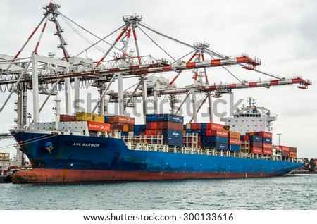 Melbourne, Australia - July 25, 2015: Australian National Line container ship ANL Barwon being unloaded at the Port of Melbourne. ANL Barwon flies the flag of Liberia.