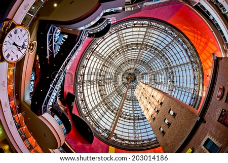 MELBOURNE, AUSTRALIA - JULY 3  2014: Melbourne's Shot Tower which was built on the site in 1888 is an iconic building contained underneath a massive glass dome at the Melbourne Central shopping centre - stock photo