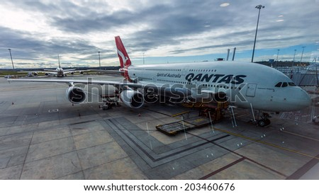 MELBOURNE, AUSTRALIA- JUNE 3, 2014: Preparing of a Qantas airplane for flight in Terminal 2 at Melbourne Tullamarine Airport  This is the second busiest airport in Australia