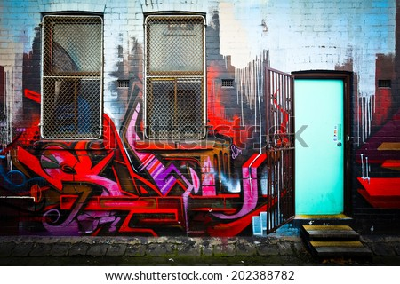 MELBOURNE, AUSTRALIA - JUNE 28 2014: Street art by unidentified artist. Melbourne's graffiti management plan recognizes the importance of street art in a vibrant urban culture - stock photo
