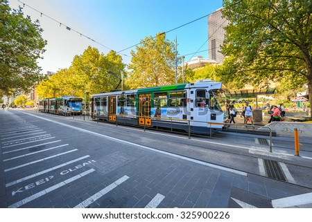 MELBOURNE, AUSTRALIA - MAR 20: Trams services on Mar 20, 2015 in Melbourne. The network consisted of 250 Kms of track, 493 trams and 25 routes which is the largest urban tramway network in the world. - stock photo