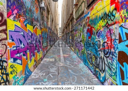 MELBOURNE, AUSTRALIA - MARCH 16, 2015: Colorful graffiti in narrow alley of downtown. - stock photo