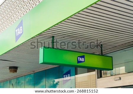 MELBOURNE, AUSTRALIA - March 25, 2015: the TAB (short for Totalisator Agency Board) is wagering business owned by Tabcorp Holdings Ltd. It provides betting services for many sports, including racing. - stock photo