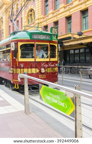 Melbourne, Australia - March 5, 2016: Vintage tram, City Circle stops at the Free tram zone in a tram station in downtown Melbourne, Australia. Travel on trams within this zone is free. - stock photo