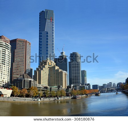 Melbourne, Australia - May 14, 2015: The South Bank of the Yarra River. Popular with locals and tourists for restaurants, bars and cafes. Eureka tower in background.