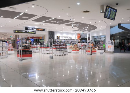 MELBOURNE AUSTRALIA - May 24, 2014: Unidentified people shop at Melbourne Airport duty free shops - Melbourne Airport is the primary airport serving Melbourne and hub for Qantas airlines  - stock photo