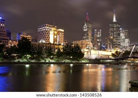 MELBOURNE, AUSTRALIA - NOV 22: Melbourne CBD night panorama with Flinders station from Yarra River at night on November 22, 2011, Melbourne, Australia. Lighting along Yarra makes recognizable views