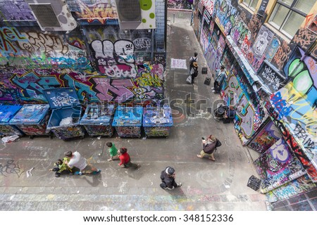 Melbourne, Australia - Nov 14, 2015: Tourists visiting the Hosier Lane in Melbourne, Australia. It is a popular laneway in Melbourne due to its graffitti covered walls and urban art.