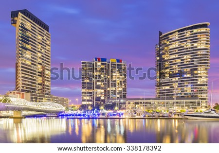 Melbourne, Australia - November 3, 2015: View of modern residential buildings, and marina with reflection in Docklands, Melbourne at twilight.  - stock photo