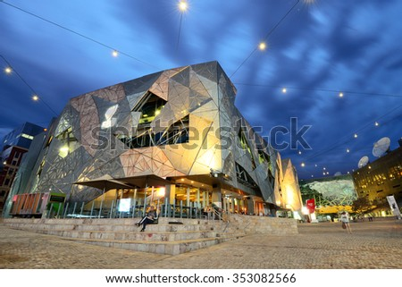 MELBOURNE, AUSTRALIA - OCTOBER 25, 2015: Night view of the Federation square in Melbourne, Australia. Federation Square is a mixed-use development in the inner city of Melbourne. - stock photo