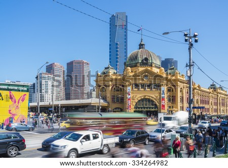 Melbourne, Australia - October 8, 2015: View of the busy Flinders Street with communters and transport, Flinders Street Railway Station and modern buildings in Melbourne.     - stock photo