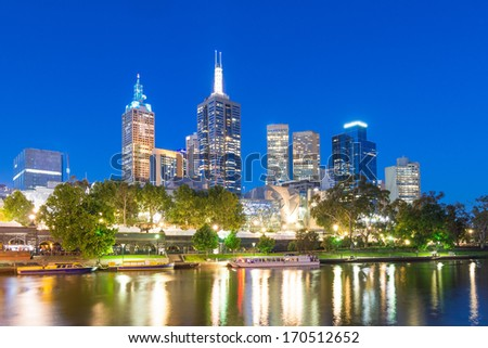 Melbourne city and Federation Square against a blue night sky - stock photo